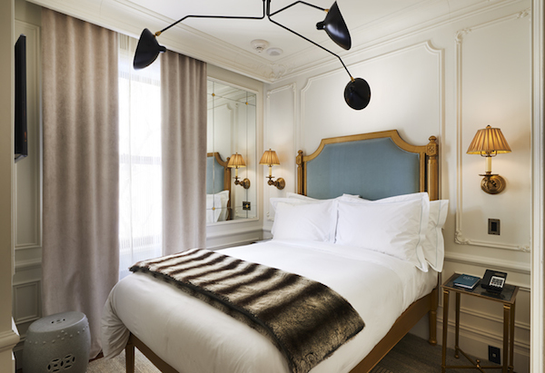 The bedroom of The Marlton Hotel in NYC