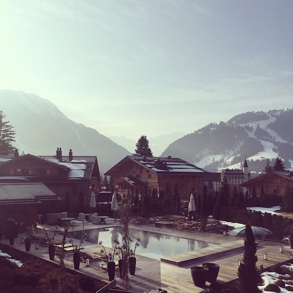 View of the outdoor pool from the suite at Alpina Gstaad
